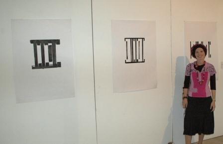 Noa Cohen next to her display