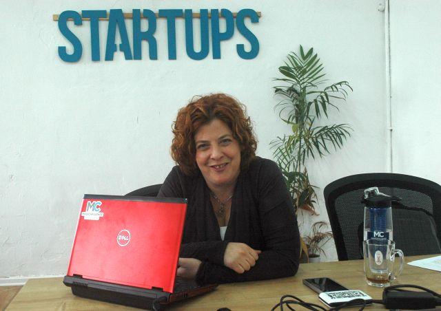 Meirav at her desk