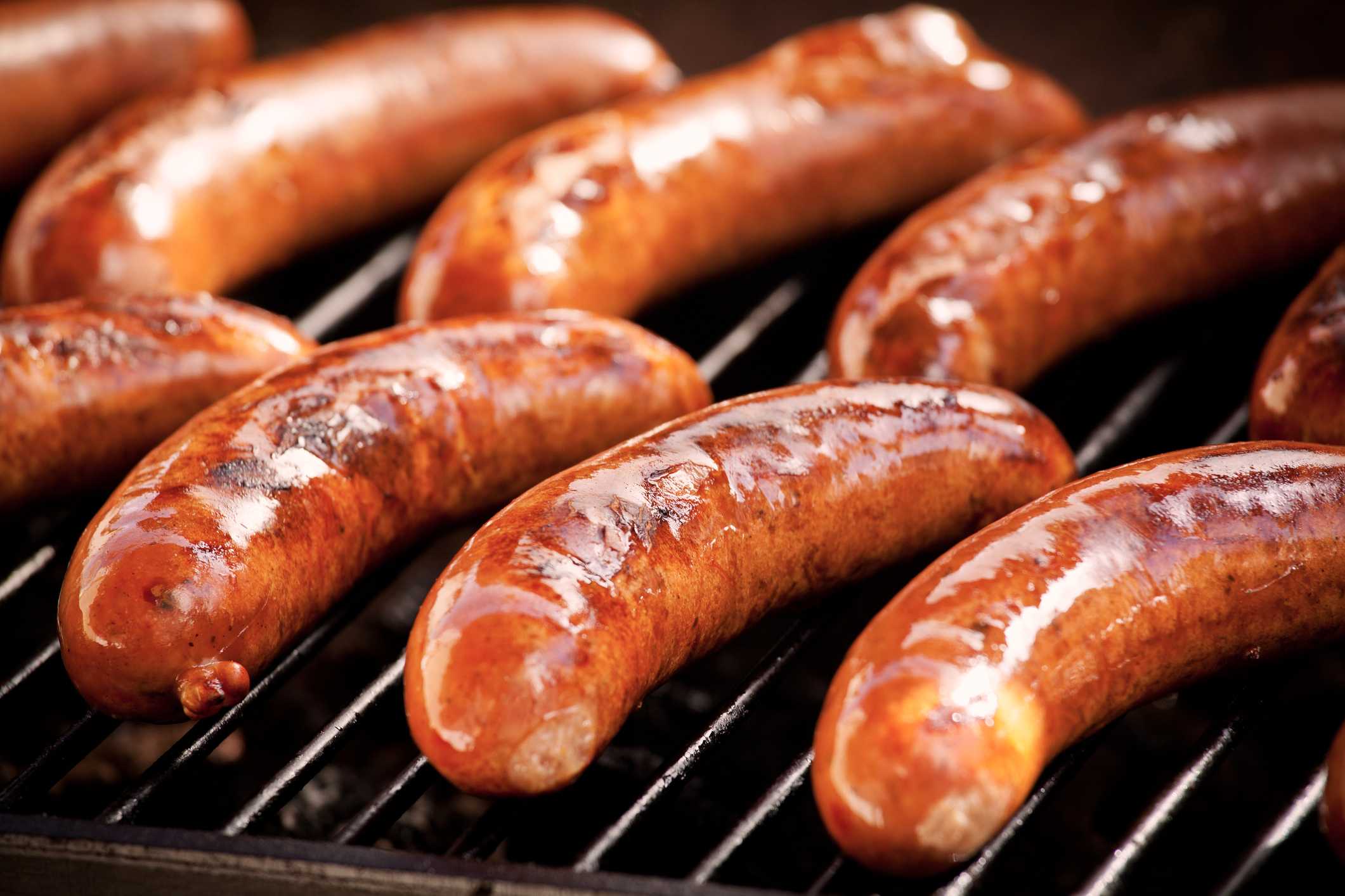 Bunch of tasty sausages on the grill
