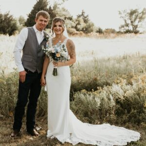 A bride and groom in an open field