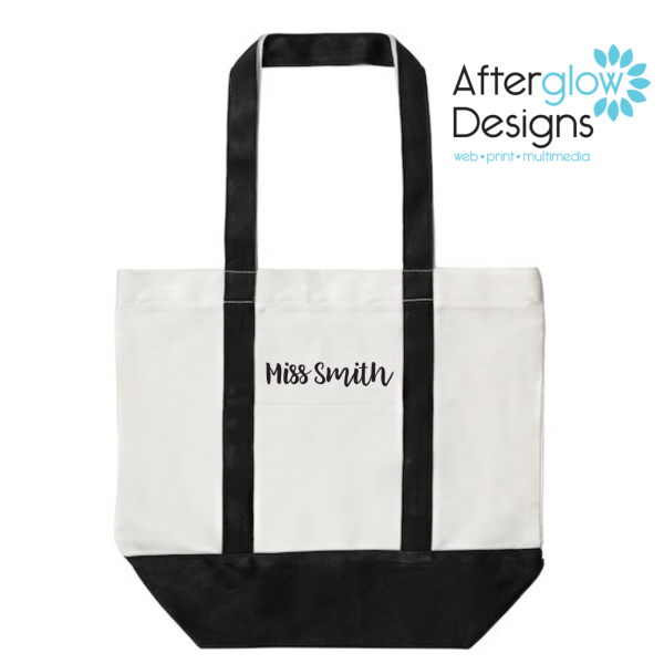 """""""The Influence of a Good Teacher Can Never Be Erased"""" on Black Tote Bag Personalize Back"""