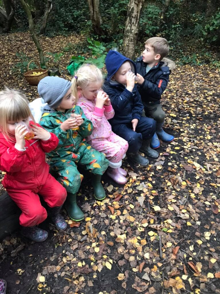 The children enjoy a drink of apple juice