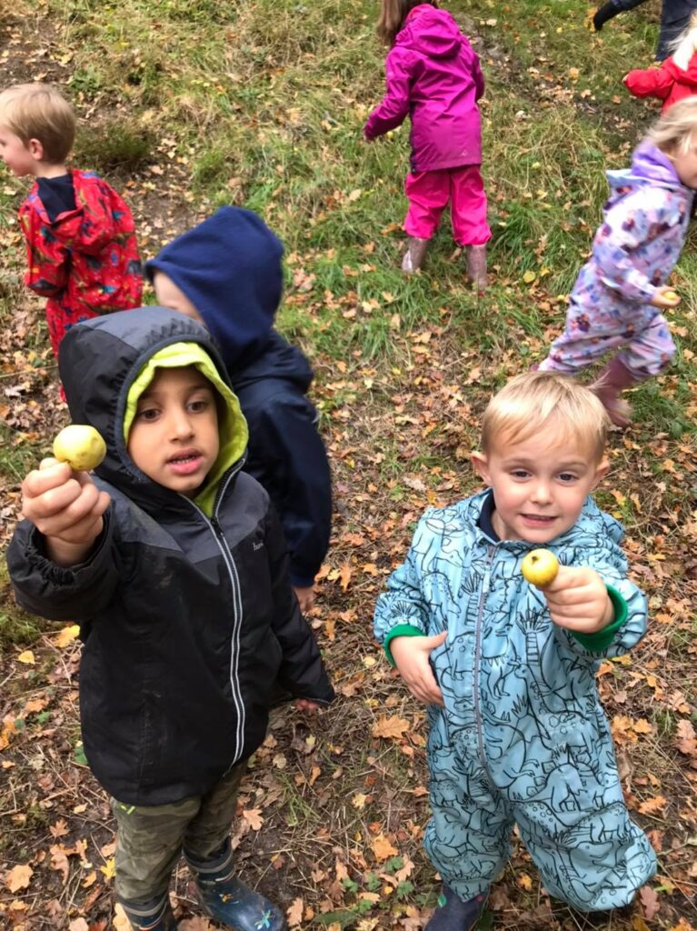 The children collecting crabapples