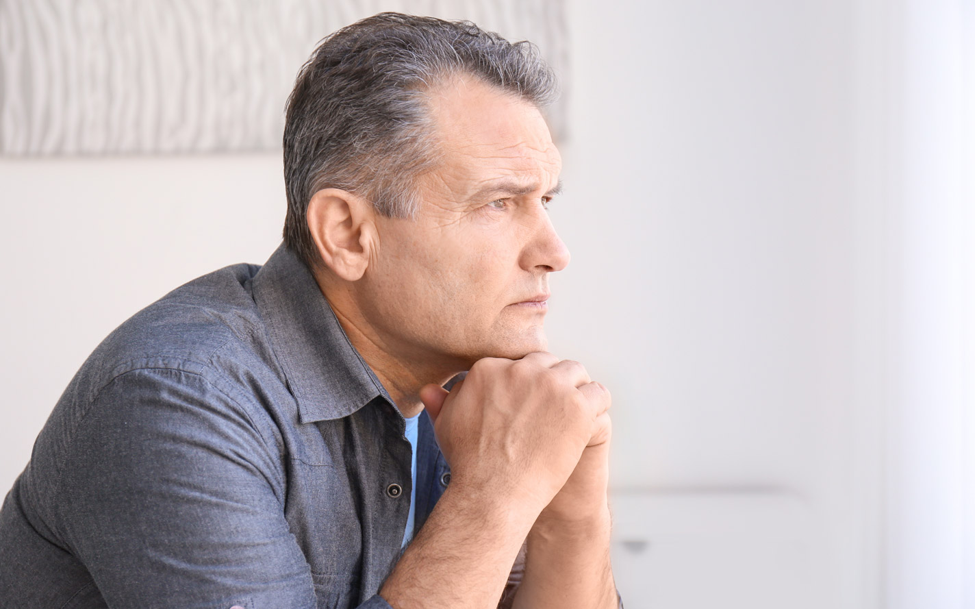 Older man contemplating his health.