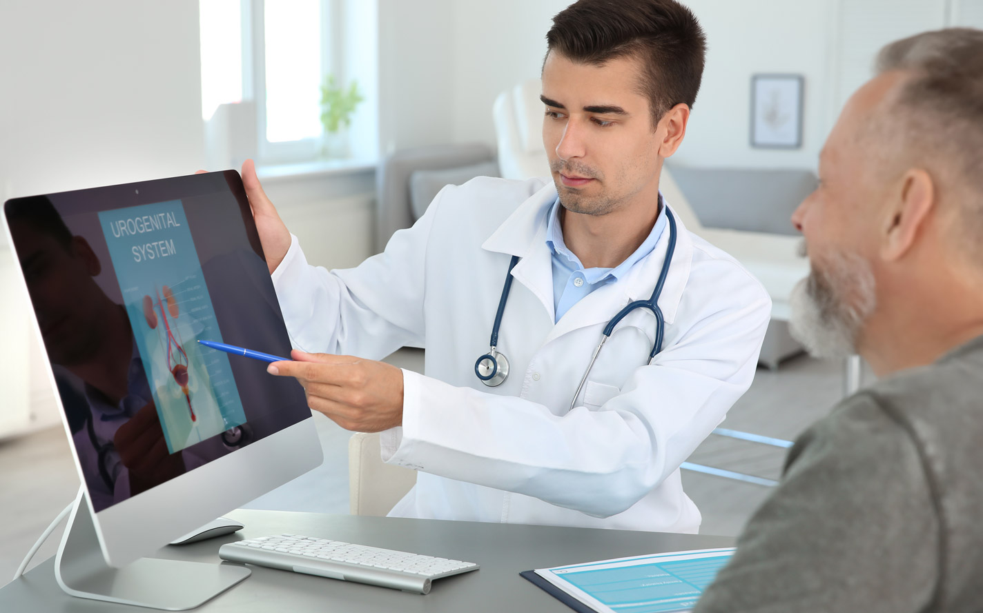 Doctor going over information with a patient.