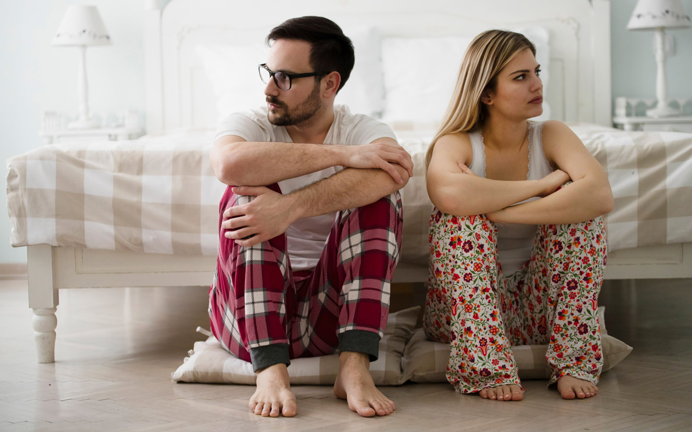 man with peyronies disease facing away from his wife.