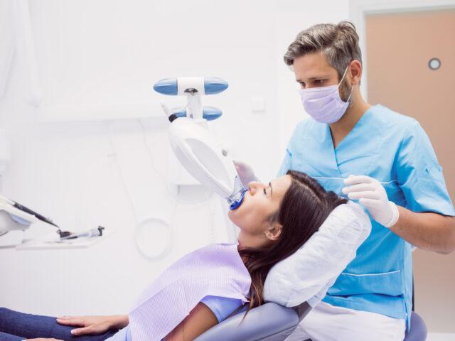 Patient receiving a dental treatment at clinic