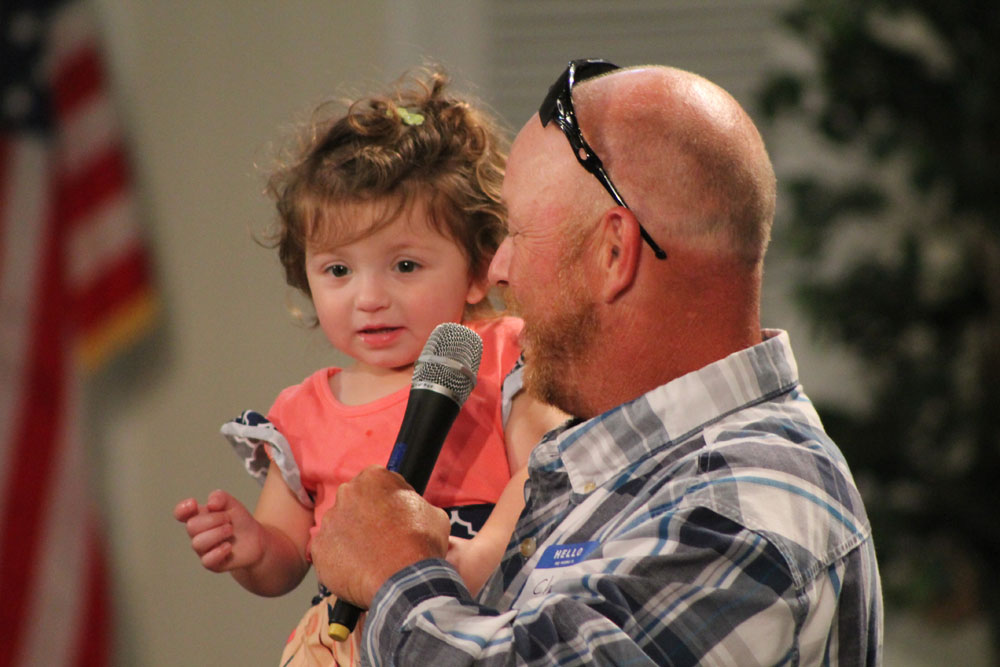 Chad Courier – 2015 graduate with daughter