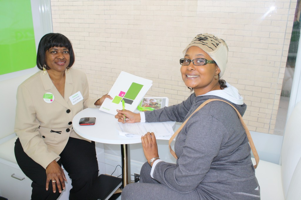 Authorized Humana insurance agent Phyllis Rhodes (left) answers questions and starts the enrollment process for Vieanna Nichols (right).