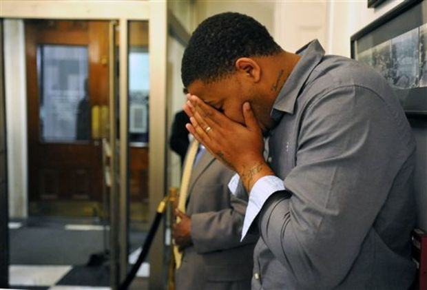 Jackson city employee Tommie Mabry, right, holds his head in his hands as he listens to the announcement of the death of Jackson Mayor Chokwe Lumumba during a news conference, Tuesday, Feb. 25, 2014, at Jackson City Hall in Jackson, Miss. Lumumba, a prominent attorney and former human rights activist who persuaded local voters into accepting a sales tax to fix crumbling roads and infrastructure in Mississippi's capital city, died Tuesday, authorities said. He was 66. (AP Photo/The Clarion-Ledger, Rick Guy)