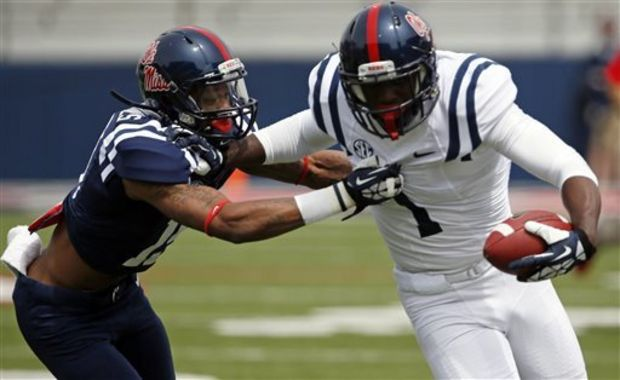 Mississippi wide receiver Laquon Treadwell (1) pushes away from defensive back Derrick Jones (19) after receiving a pass during an NCAA college football spring scrimmage on Saturday, April 5, 2014, in Oxford, Miss. (AP Photo/Rogelio V. Solis)