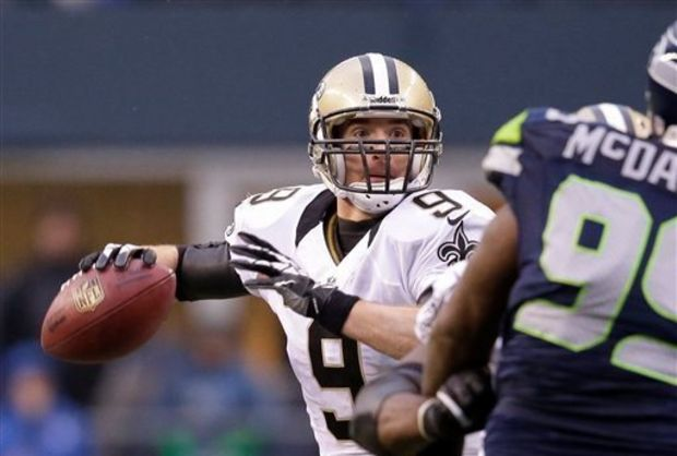 Drew Brees and the New Orleans Saints will open the 2014 preseason at St. Louis. (Elaine Thompson/AP Photo)