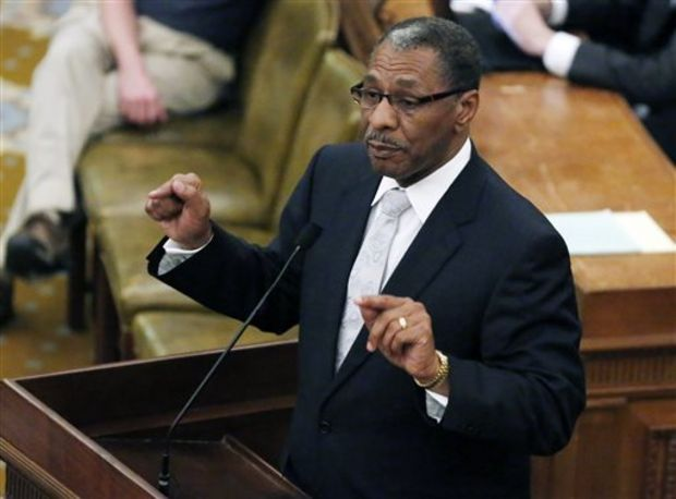 Rep. Ed Blackmon, D-Canton, argues against a bill that would have banned texting while driving, Wednesday night, April 2, 2014 at the Capitol in Jackson, Miss. The bill had passed Tuesday, and Rep. Bill Denny, R-Jackson, put a procedural hold on the bill late Wednesday. The House voted not to remove that hold, so the bill died when the session ended. (AP Photo/Rogelio V. Solis)