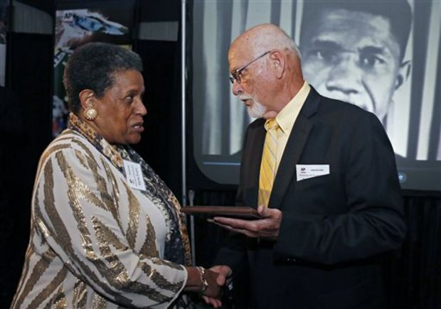 Myrlie Evers-Williams, widow of the murdered Mississippi civil rights leader Medgar Evers, receives the 2014 Mississippi Associated Press Broadcasters Pioneers of Television award from retired Jackson, Miss., bureau Associated Press news editor Ron Harrist for breaking the color barrier on his behalf during the organization's annual awards dinner in Jackson, Miss., Saturday, April 26, 2014. Evers led efforts to be granted equal air time for a social justice commentary at a Jackson television station in 1963. His appearance and subsequent on-air speech on the goals of the Jackson movement of the NAACP were the first for a black person at WLBT-TV. Evers was killed outside his home later that month. (AP Photo/Rogelio V. Solis