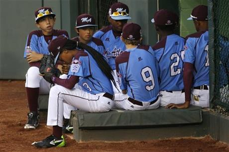 Philadelphia pitcher Mo'ne Davis, center from left, waits to take the field with her teammates for a United States semi-final baseball game against Las Vegas at the Little League World Series tournament in South Williamsport, Pa., Wednesday, Aug. 20, 2014. (AP Photo/Gene J. Puskar)