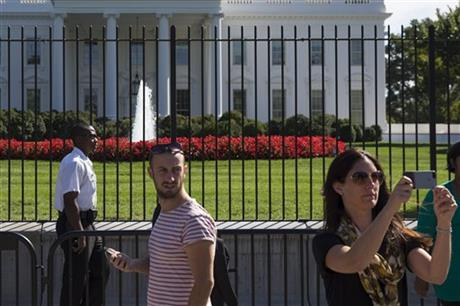 FILE - In this Sept. 22, 2014, file photo, a Uniformed Secret Service police officer stands outside the White House in Washington. The intruder who climbed a fence made it farther inside the White House than the Secret Service has publicly acknowledged, the Washington Post and New York Times newspapers reported Monday, Sept. 29. The disclosures came on the eve of a congressional oversight hearing with the director of the embattled agency assigned to protect the president's life. (AP Photo/Evan Vucci, File)