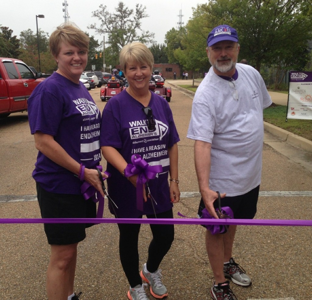 Mississippi First Lady Deborah Bryant (center), Mississippi Chapter Alzheimer's Association Executive Director Patty Dunn (left) and Board President Marshall Belaga, M.D. participate in the ribbon-cutting to start the walk