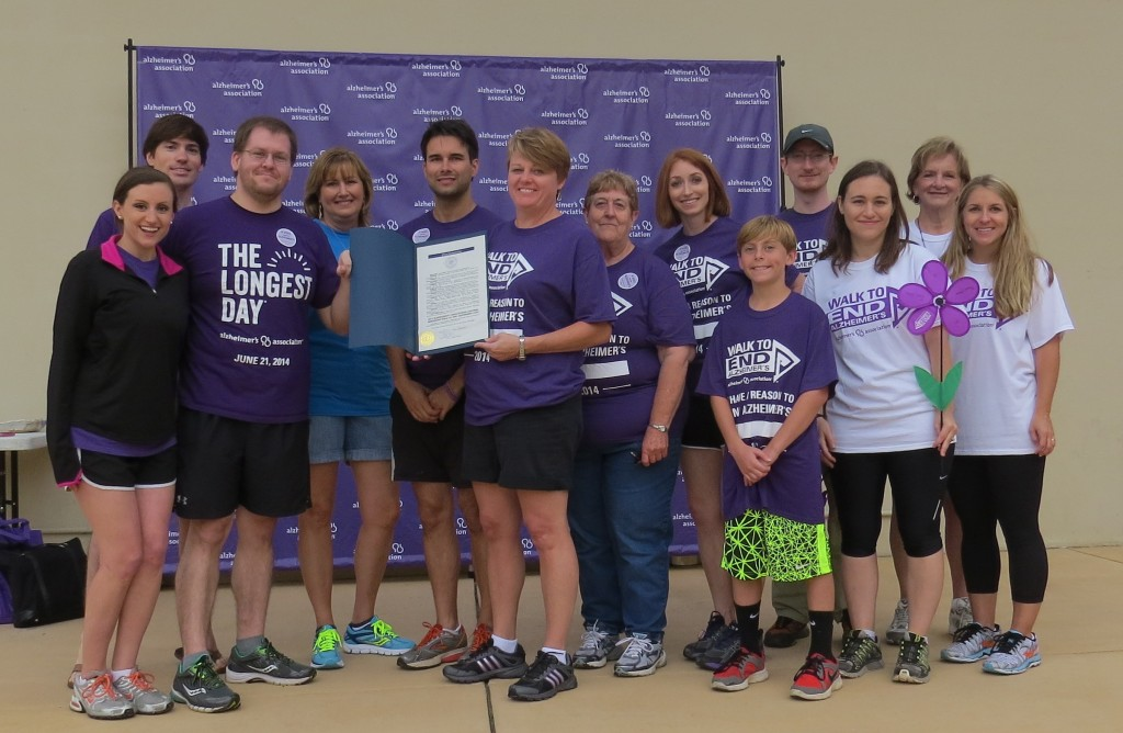 p2 Executive Director Patty and committee display proclamation