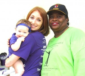 Mississippi Chapter Alzheimer's Association Program Coordinator Sara Murphy and daughter (R) pose with Chapter board member Gail M. Brown.