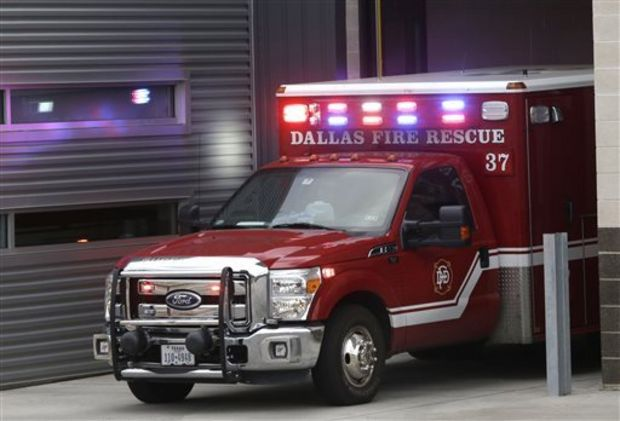 An ambulance pulls into the Dallas Fire-Rescue station 37 in Dallas, Wednesday, Oct. 1, 2014. Three EMT's from this location are under a 21 day quarantine after a patient they transported tested positive for Ebola. (AP Photo/LM Otero)