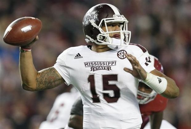 Mississippi State quarterback Dak Prescott throws the ball against Alabama during the second half of an NCAA college football game Saturday, Nov. 15, 2014, in Tuscaloosa, Ala. Alabama won 25-20. (AP Photo/Brynn Anderson)