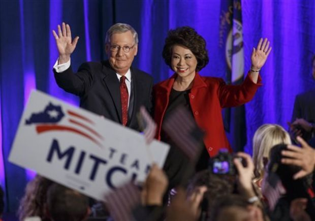 Senate Minority Leader Mitch McConnell of Ky., joined by his wife, former Labor Secretary Elaine Chao, celebrates with his supporters at an election night party in Louisville, Ky.,Tuesday, Nov. 4, 2014. McConnell won a sixth term in Washington, with his eyes on the larger prize of GOP control of the Senate. The Kentucky Senate race, with McConnell, a 30-year incumbent, fighting off a spirited challenge from Democrat Alison Lundergan Grimes, has been among the most combative and closely watched contests that could determine the balance of power in Congress. (AP Photo/J. Scott Applewhite)