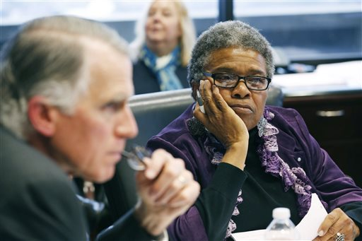 Task force member Constance Slaughter-Harvey, right, and Andy Taggart, co-chairman of a task force established to review Mississippi Department of Corrections contracts listen to comments from other members at its meeting in Jackson, Miss., Friday, Dec. 19, 2014. The task force has been charged by Republican Gov. Phil Bryant to recommend changes requiring more accountability in how the agency purchased goods or hired people to provide services. The bipartisan, five-member task force was established to examine the agency's spending practices after former Corrections Commissioner Christopher Epps and a businessman were indicted last month on federal corruption charges. (AP Photo/Rogelio V. Solis)
