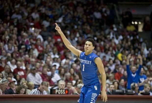 Kentucky guard Devin Booker (1) celebrates after scoring during the second half of an NCAA college basketball game against Alabama, Saturday, Jan. 17, 2015, in Tuscaloosa, Ala. Kentucky won 70-48. (AP Photo/Brynn Anderson)