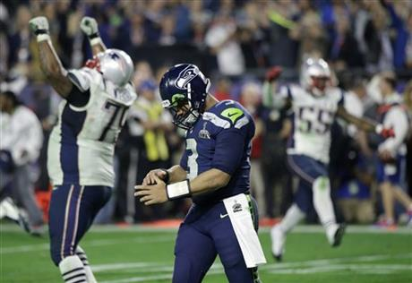 Seattle Seahawks quarterback Russell Wilson (3) walks off the field after throwing an interception to New England Patriots strong safety Malcolm Butler during the second half of NFL Super Bowl XLIX football game Sunday, Feb. 1, 2015, in Glendale, Ariz. (AP Photo/David Goldman)