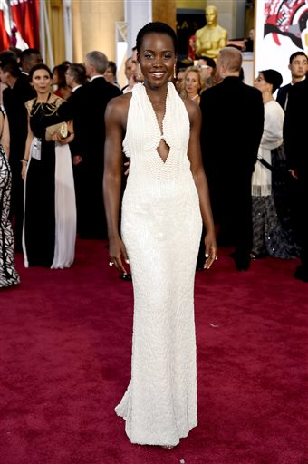 In this Feb. 22, 2015 file photo, actress Lupita Nyong'o arrives at the Oscars wearing a dress made of pearls at the Dolby Theatre in Los Angeles. Los Angeles sheriff's detectives are investigating the theft of the $150,000 custom Calvin Klein dress worn by Nyong'o at the 2015 Academy Awards. The dress was reported stolen from Nyong'o's West Hollywood hotel room late on Wednesday Feb. 25, 2015. (Photo by Chris Pizzello/Invision/AP, File)