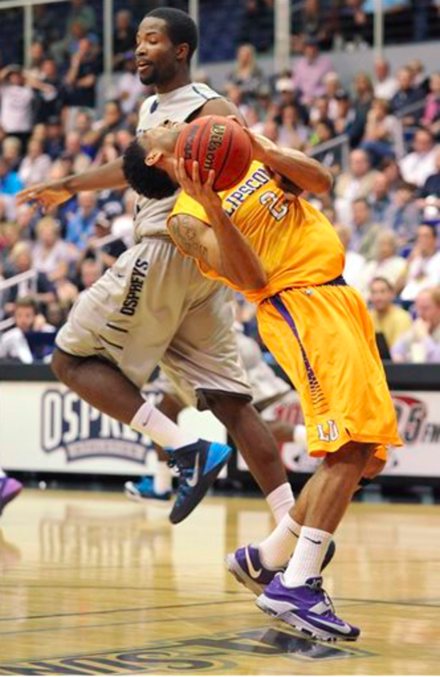 Lipscomb's Josh Williams reels backward after a passing collision from North Florida's Demarcus Daniels during the first half of an NCAA college basketball game in the Atlantic Sun men's tournament Thursday night, March 5, 2015, in Jacksonville, Fla. (AP)