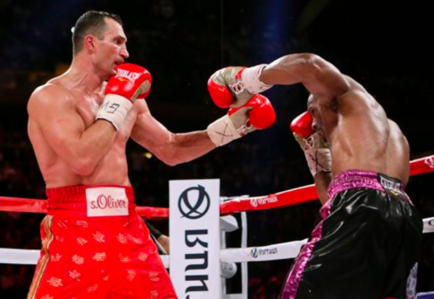Wladimir Klitschko, of Ukraine, left, throws a left at Bryant Jennings during the 12th round of a heavyweight boxing match early Sunday, April 26, 2015, at Madison Square Garden in New York. Klitschko won the fight by unanimous decision. (AP)