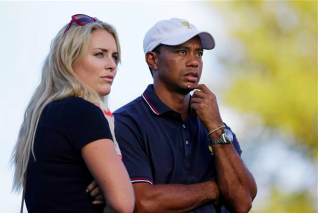 This Oct. 3, 2013 file photo shows Tiger Woods watching with his girlfriend Lindsey Vonn at the Presidents Cup golf tournament at Muirfield Village Golf Club in Dublin, Ohio. Vonn announced on Sunday, May 3, 2015, that she and Woods have decided to end their three-year relationship. (AP)