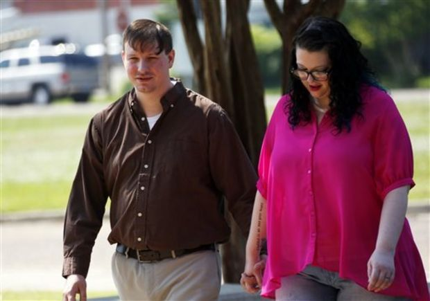 Clayton Kelly, a political blogger, and his wife Tara walk back to the Madison County Courthouse in Canton, Miss., during a morning break at pre-trial motions for his trial trial, Monday, June 8, 2015. Kelly is accused of taking an unauthorized video U.S. Sen. Thad Cochran's late wife when she was in a nursing home, bedridden with dementia. Kelly, a 29-year-old Pearl resident, was indicted on charges of conspiracy, attempted burglary and burglary. Images of Rose Cochran appeared online briefly during the 2014 election, during a tough Republican primary. (AP Photo/Rogelio V. Solis)