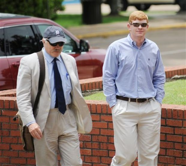 Former Ole Miss student Graeme Phillip Harris, right, with his attorney David Hill, enter federal court, where Harris pleaded guilty to a charge of using a threat of force to intimidate African-American students and employees at the university, in Oxford, Miss. on Thursday, June 18, 2015. Harris, of Alpharetta, Ga., pleaded guilty Thursday to a misdemeanor charge arising from a noose placed on a statue of civil rights activist James Meredith. (Bruce Newman/Oxford Eagle via AP)