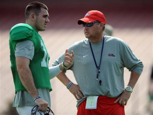 Mississippi quarterback Chad Kelly, left, talks with head coach Hugh Freeze during NCAA college football practice in Oxford, Miss., Monday, Aug. 10, 2015. (Bruce Newman/Oxford Eagle)