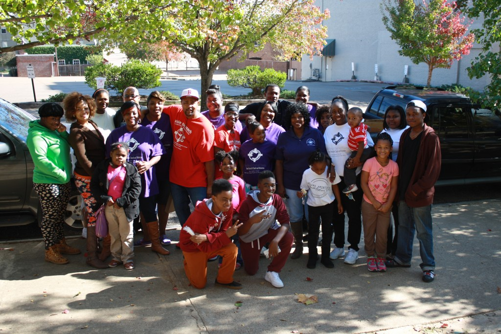 Members of Vision Outreach Church and Ministries gather at Smith Park Saturday.