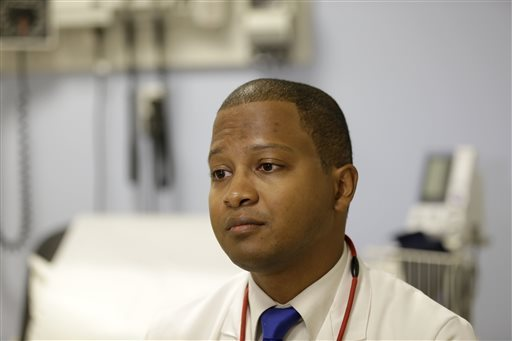 Dr. Raymond Givens speaks during an interview at Columbia University Medical Center in New York. Givens was the leader of a new study that found that wealthy people are more likely to get themselves onto multiple transplant waiting lists and score a donated organ, and less likely to die while waiting for one to become available. (AP Photo/Seth Wenig)