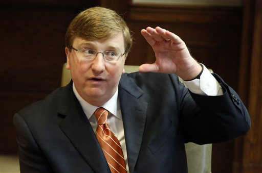 Republican Lt. Gov. Tate Reeves gestures during a discussion about Mississippi voters rejecting a school funding proposal on Tuesday's ballot, during a sit down with reporters in his office at the Capitol in Jackson, Miss., Wednesday, Nov. 4, 2015 following yesterday's general election. Reeves said he is willing to put more money into efficient school systems that demonstrate strong academic performance. (Rogelio V. Solis/AP Photo)