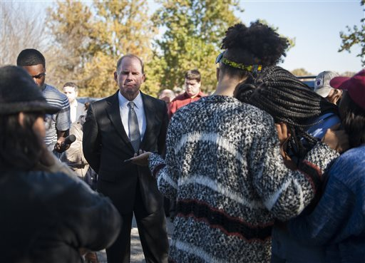 In a Tuesday, Nov. 3, 2015 photo, University of Missouri President Tim Wolfe speaks with members of Concerned Student 1950 senior DeShaunya Ware, right, and junior Shelbey Parnell, center, as they call for Wolfe's resignation outside University Hall in Columbia, Mo. Wolfe resigned Monday, Nov. 9, 2015, amid criticism of handling of racial issues. (Daniel Brenner/Columbia Daily Tribune via AP)