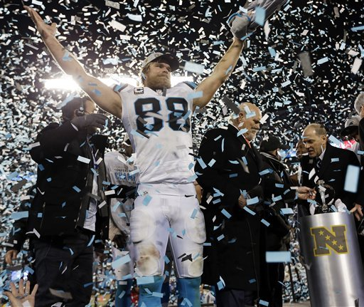 Carolina Panthers' Greg Olsen celebrates after the NFL football NFC Championship game against the Arizona Cardinals, Sunday, Jan. 24, 2016, in Charlotte, N.C. The Panthers won 49-15 to advance to the Super Bowl. (David J. Phillip/The Associated Press)