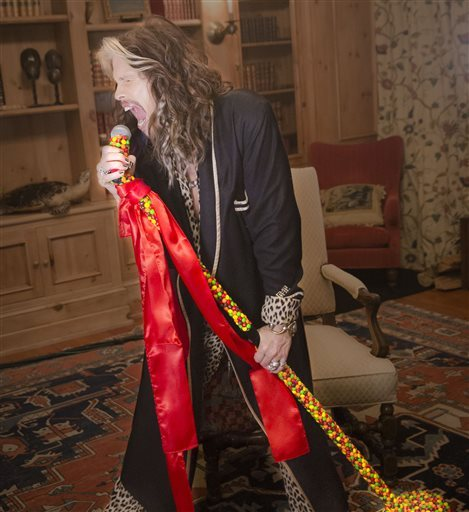 This image provided by the Wm. Wrigley Jr. Company shows Aerosmith front man Steven Tyler promoting Skittles in the company's Super Bowl 50 ad. This is the first time Skittles has ever featured a celebrity in a TV commercial, and the brand's second Super Bowl ad after debuting during the 2015 Super Bowl. Wm. Wrigley Jr. Co.