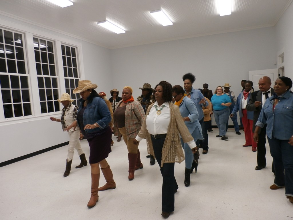 Line dancing at the western-style gala fundraiser sponsored by the National Alumni Association