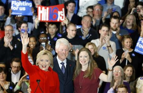 Democratic presidential candidate Hillary Clinton, from left, former President Bill Clinton and daughter Chelsea acknowledge supporters during a caucus night party at Drake University in Des Moines, Iowa, Monday, Feb. 1, 2016. (AP Photo/Patrick Semansky)