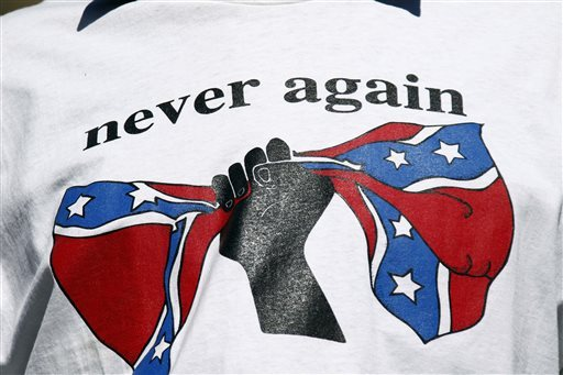 A change-the-flag supporter wears a T-shirt calling for the removal of the Confederate battle emblem from the Mississippi flag at a rally at the Capitol in Jackson, Miss., Thursday, Feb. 18, 2016. The Mississippi Legislature will not take any steps to change the flag during this year's session. (AP file photo)