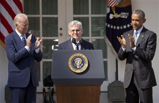 Federal appeals court judge Merrick Garland, receives applauds from President Barack Obama and Vice President Joe Biden as he is introduced as Obama's nominee for the Supreme Court during an announcement in the Rose Garden of the White House, in Washington, Wednesday, March 16, 2016. Garland, 63, is the chief judge for the United States Court of Appeals for the District of Columbia Circuit, a court whose influence over federal policy and national security matters has made it a proving ground for potential Supreme Court justices. (Pablo Martinez Monsivais/The Associated Press)