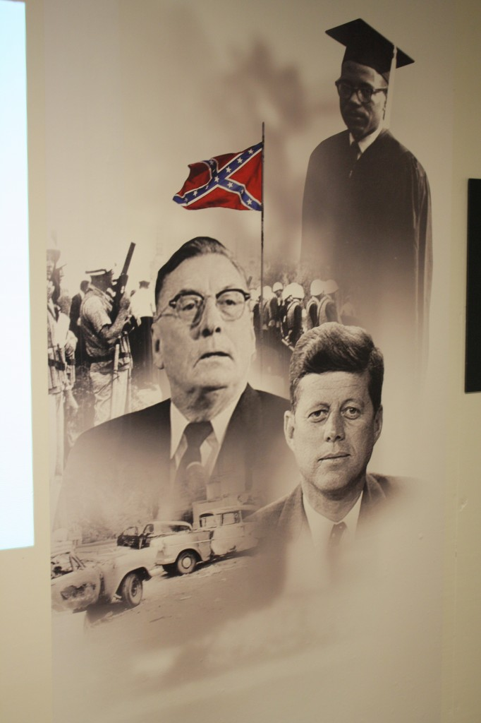 This image on display features President John F. Kennedy, former Mississippi Gov. Ross Barnett and James Meredith.