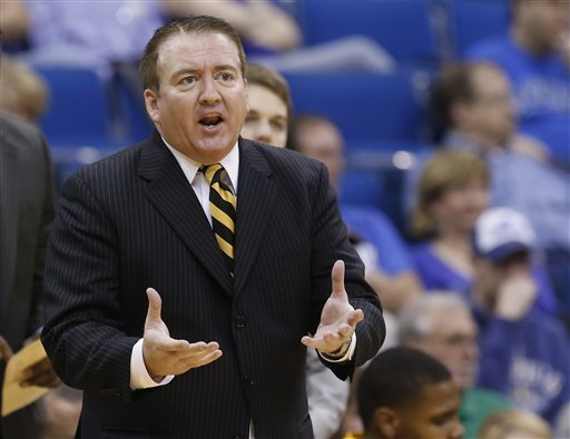 In this March 16, 2013, file photo, then-Southern Miss head coach Donnie Tyndall gestures during the championship game in the Conference USA men's NCAA college basketball tournament in Tulsa, Okla Former Southern Mississippi basketball coach Donnie Tyndall has been hit with a 10-year show cause by the NCAA for his role in rules violations that occurred at the school during his tenure. The NCAA released its ruling in the case on Friday, April 8, 2016. (AP file photo)