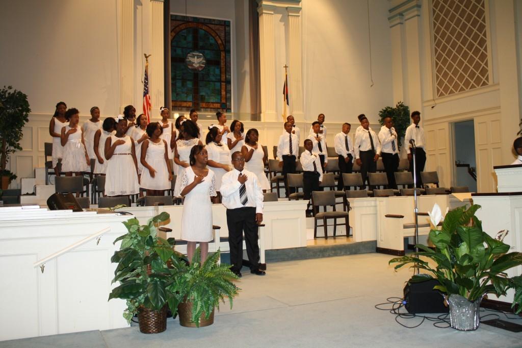 Lester Elementary School fifth-graders recite the Pledge of Allegiance.