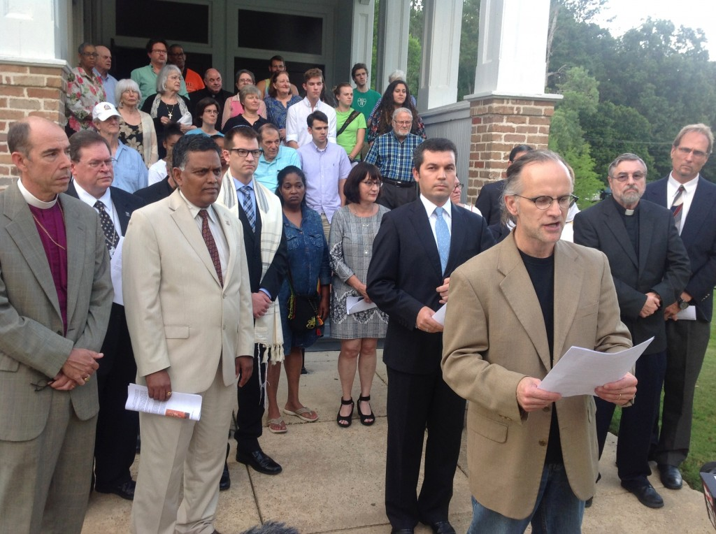 James Bowley (front, center), chair of Religious Studies at Millsaps College and member of the Mississippi Religious Leadership Conference and Voices Against Extremism, addressed the press during the prayer vigil held at Tougaloo College Tuesday evening.  PHOTO BY AYESHA K. MUSTAFAA